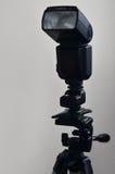Speedlight gun with trigger set mounted on tripod Royalty Free Stock Photos