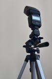 Speedlight gun with trigger set mounted on tripod Stock Photo