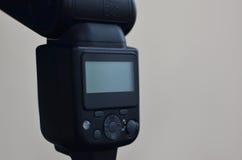 Speedlight gun with trigger set mounted on tripod Royalty Free Stock Photo