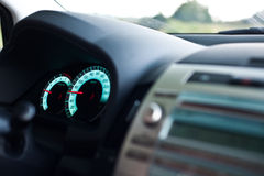 Speedo. Selected focus on the speedometer of a moving car Stock Photos
