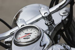 Speedo on motocycle. Speedometer on the tank of a highly chromed motocycle Stock Images