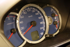 Speedometer. Driving speed speedometer gauge on car dashboard Stock Images