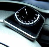 Speedometer arrow in reflection on the glass display of smartphone close up. Car speedometer arrow and digits in reflection on the glass display of smartphone Royalty Free Stock Photos