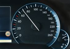 Speedometer of a car. Showing 70, speeing at the 40 speed limit Stock Photos