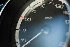 Speedometer. A speedometer in a car which goes up to 220 km/h Stock Image