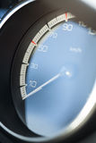 Speedometer. A speedometer in a car which goes up to 220 km/h Stock Photos