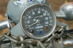 Speedometer of circa mid 1960 classic and vintage Yamaha motorcycle. CHONBURI, THAILAND - MARCH 14, 2018 : Speedometer of circa mid 1960 classic and vintage stock photography