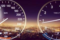 Speedometer on city background stock image