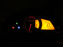 Speedometer in Dark. A digital speedometer of a superb bike Bajaj Pulser 200 NS Stock Photo