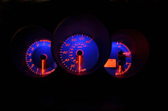 Speedometer dashboard. Illuminated dashboard in a car at night stock images