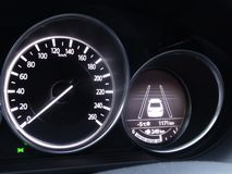Speedometer and display of collision avoidance assist on car dashboard. Speedometer and display of active collision prevention assist on car dashboard stock photography