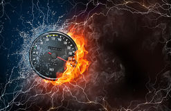 Speedometer on fire and water. With lightening around on black background. Horizontal layout with text space Royalty Free Stock Photos