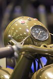 Speedometer and headlight of old green soviet motorcycle closeup Royalty Free Stock Photography