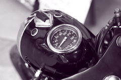 Speedometer and headlight of old motorcycle in black and white closeup Stock Image