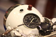 Speedometer and headlight of old white soviet motorcycle closeup Royalty Free Stock Image
