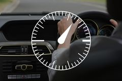 Speedometer icon against person in the car Stock Image