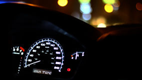 Speedometer late night with bokeh Stock Photography
