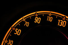 Speedometer at night inside a car Stock Photography