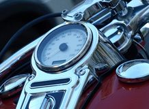 Speedometer. A speedometer or a speed meter is a gauge that measures and displays the instantaneous speed of a vehicle. Now universally fitted to motor vehicles royalty free stock image