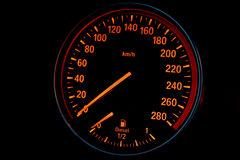 Speedometer of a sport diesel car. On black background Stock Photos