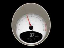 Speedometer / Tachometer. A speedometer of a fast car indicating medium velocity Stock Image