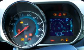 Speedometer and tachometer with additional instruments on car dash Stock Photography