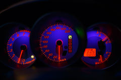 Speedometer, tachometer and fuel by night Stock Photos