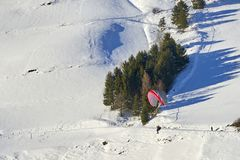 Speedrider with red and gray wing skis in close proximity to a steep slope. Ischgl, Austria - December 24, 2017: Austrian Alps ski resort Ischgl. Speedrider with Royalty Free Stock Photography