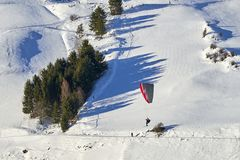 Speedrider with red and gray wing skis in close proximity to a steep slope. Ischgl, Austria - December 24, 2017: Austrian Alps ski resort Ischgl. Speedrider with Stock Image