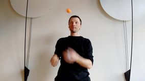 Speedup juggler. Funny show with juggling man stock video