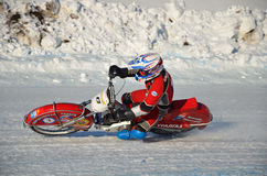 Speedway on ice, turn on a motorcycle Stock Photos