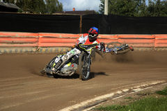 Speedway race, fall down of racer. The Amateur competition in Speedway in Daugavpils (Latvia). August 2014 royalty free stock photography