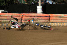 Speedway race, fall down of racer. The Amateur competition in Speedway in Daugavpils (Latvia). August 2014 royalty free stock photos