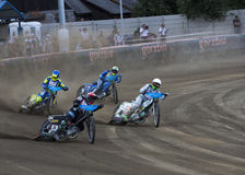 Speedway racers on the track. DAUGAVPILS, LATVIA - JULY 18, 2015: 5th stage of speedway Gran Prix. Speedway racers on the track stock image