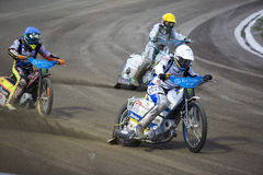 Speedway racers on the track Royalty Free Stock Image