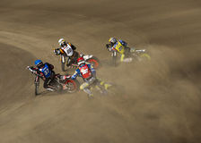 Speedway racers on the track Royalty Free Stock Photos