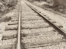 Speedway railroad old rail railroad track vintage retro sepia. Close up closeup of a speedway railroad old rail railroad track vintage retro sepia stock photography