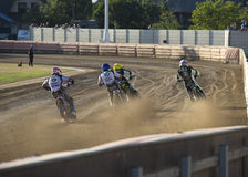 Speedway rider on the track Stock Photos