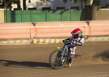 Speedway rider on the track Stock Image