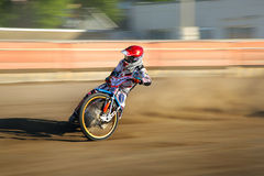 Speedway rider on the track Stock Photography