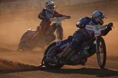 Speedway riders compete on track in Pardubice, Czech Republic. Stock Photos