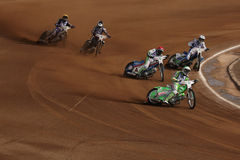 Speedway riders compete on track in Pardubice, Czech Republic. Royalty Free Stock Photo