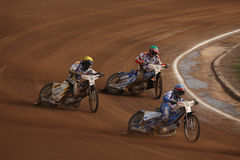 Speedway riders compete on track in Pardubice, Czech Republic. PARDUBICE, CZECH REPUBLIC - OCTOBER 14, 2012: Speedway riders compete on track during the Golden stock photos