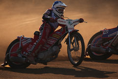 Speedway riders compete on track in Pardubice, Czech Republic. Royalty Free Stock Photography