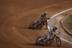 Speedway riders compete on track in Pardubice, Czech Republic. PARDUBICE, CZECH REPUBLIC - OCTOBER 14, 2012: Speedway riders compete on track during the Golden stock photo