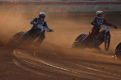 Speedway riders compete on track in Pardubice, Czech Republic. PARDUBICE, CZECH REPUBLIC - OCTOBER 14, 2012: Speedway riders compete on track during the Golden royalty free stock photos