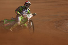 Speedway riders compete on track in Pardubice, Czech Republic. Stock Photography