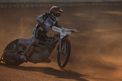 Speedway riders compete on track in Pardubice, Czech Republic. PARDUBICE, CZECH REPUBLIC - OCTOBER 14, 2012: Speedway rider competes on track during the Golden stock photography