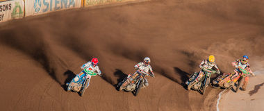 Speedway riders cornering. Speedway / Dirtbike racers fighting for first place Stock Photography