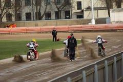 Speedway riders on the track. DAUGAVPILS, LATVIA - April 10, 2016: Speedway riders on the track in match of polish NICE league Lokomotiv - Polonia stock image